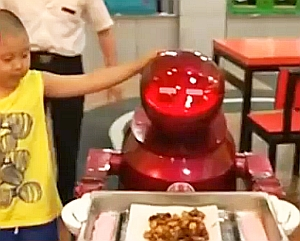 Automatischer Servierer - China liebt Roboter-Restaurants