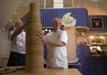 """08/02/16 Chefs at Center Parcs pile-high a flipping incredible 213 pancakes to batter the current GUINNESS WORLD RECORDS™ title for the 'Tallest stack of Pancakes'. Chefs used 14 bags of flour, 700 eggs and 26 pints of milk to construct the giant 101.8 cm tall tower at The Pancake House, Center Parcs Sherwood Forest, Nottinghamshire. Group Executive Chef, James Haywood, said: """"The trick was to find a way to construct the stack without it falling over. It wasn't just a matter of piling them up and hoping for the best – we've looked at it from a scientific, mathematic and engineering point of view, as well as developing a recipe for the perfect piling pancake."""" The previous record was set in the Netherlands two years ago and measured 91.2cm. """"The Pancake House is not just a nod to our Dutch heritage – it's something that's become synonymous with a Center Parcs break,"""" adds James. """"Since we opened our doors in 1987, we've served enough pancakes to reach the top of Mount Everest, so it seems right that we now hold this GUINNESS WORLD RECORDS title!"""" All Rights Reserved: F Stop Press Ltd. +44(0)1335 418365 +44 (0)7765 242650 www.fstoppress.com"""